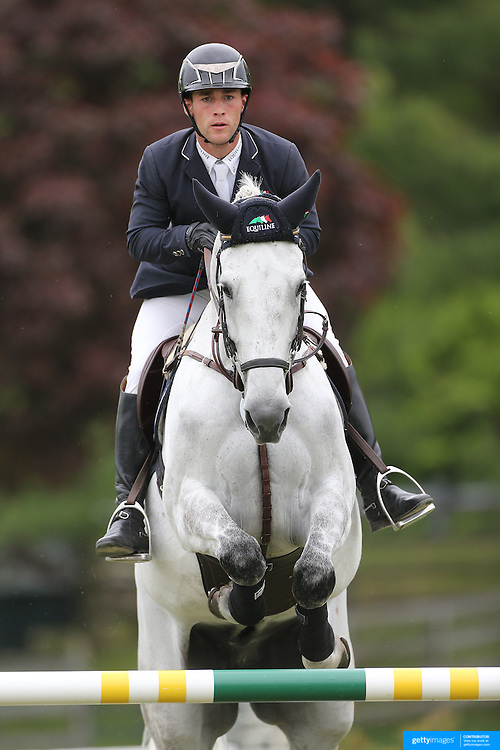 NORTH SALEM, NEW YORK - May 21: Mattias Tromp riding Triomphe Z in action during The $15,000 Under 25 T & R Development Grand Prix at the Old Salem Farm Spring Horse Show on May 21, 2016 in North Salem, New York. (Photo by Tim Clayton/Corbis via Getty Images)