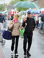 Hope Matico (left) and her husband Bud Matico, of Washington Crossing, Pa. share an umbrella as they walk on Sycamore Street during the Newtown Business Association's Welcome Day Sunday May 1, 2016 in Newtown, Pennsylvania.  (Photo by William Thomas Cain)