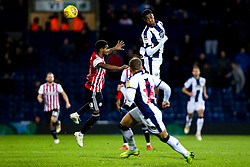 Tosin Adarabioyo of West Bromwich Albion heads the ball to Dwight Gayle of West Bromwich Albion - Mandatory by-line: Robbie Stephenson/JMP - 03/12/2018 - FOOTBALL - The Hawthorns - West Bromwich, England - West Bromwich Albion v Brentford - Sky Bet Championship