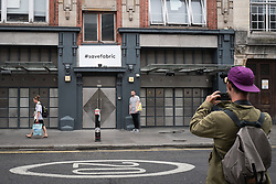 © Licensed to London News Pictures. 07/09/2016. London, UK. A man takes a photograph of his friend outside London's world famous Fabric nightclub on Charterhouse Street. Islington Council revoked the club's license on 6 September 2016 following the drug-related deaths of two 18-year-old men. The decision has drawn condemnation from across the music community. Photo credit: Rob Pinney/LNP