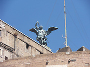 The bronze statue of Archangel Michael, standing on top of the castle of St Angelo, Rome, modelled in 1753 by Peter Anton von Verschaffelt (1710–1793).  The Mausoleum of Hadrian, usually known as the Castel St Angelo, Rome, Italy.