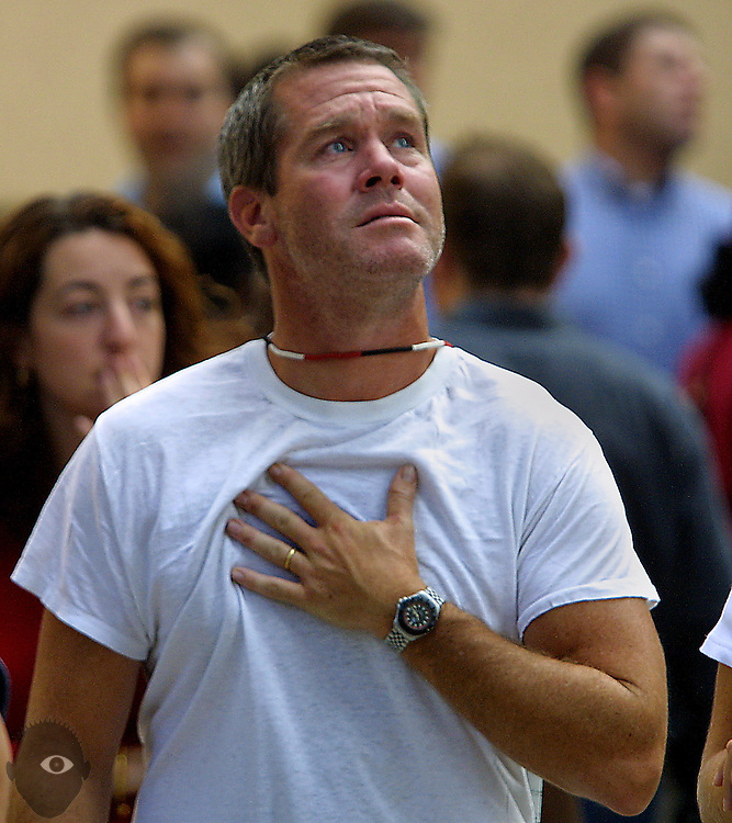 A man is overcome with emotion at finally being able to see the remains of the World Trade Towers at Ground Zero from a break in the remaining buildings.