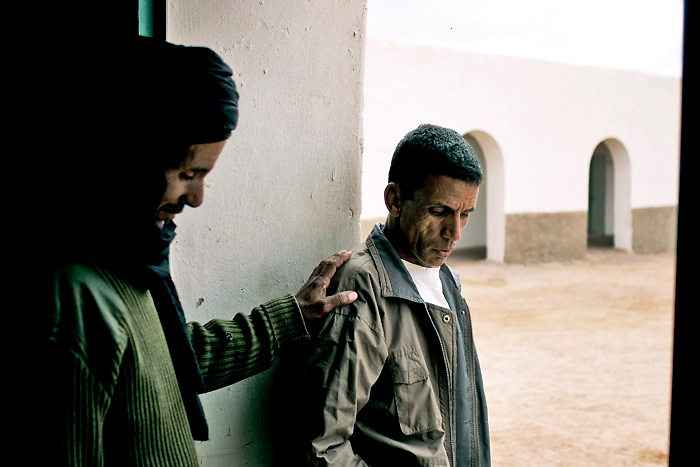 A Polisario soldier and friend await a visit from the  President of the Sahrawi Arab Democratic Republic, Mohamed Abdelaziz. He was visiting the operations base of a large-scale de-mining programme.