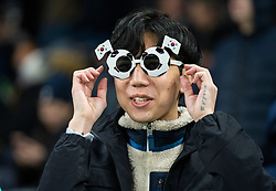 LONDON, ENGLAND - Saturday, January 11, 2020: A Tottenham Hotspur supporter wearing novelty football sunglasses with South Korean flags during the FA Premier League match between Tottenham Hotspur FC and Liverpool FC at the Tottenham Hotspur Stadium. (Pic by David Rawcliffe/Propaganda)