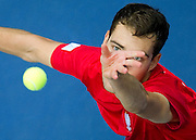 Jerzy Janowicz of Poland competes at single match during third day of the BNP Paribas Davis Cup 2013 between Poland and South Africa at MOSiR Hall in Zielona Gora on April 07, 2013...Poland, Zielona Gora, April 07, 2013..Picture also available in RAW (NEF) or TIFF format on special request...For editorial use only. Any commercial or promotional use requires permission...Photo by © Adam Nurkiewicz / Mediasport