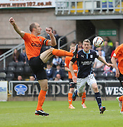 Dundee United's Sean Dillon clears from Dundee's Jim McAlister - Dundee United v Dundee at Tannadice Park in the SPFL Premiership<br /> <br />  - © David Young - www.davidyoungphoto.co.uk - email: davidyoungphoto@gmail.com