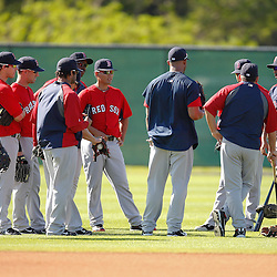 February 19, 2011; Fort Myers, FL, USA; Boston Red Sox outfielders meet on the field during spring training at the Player Development Complex.  Mandatory Credit: Derick E. Hingle