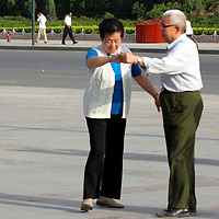 Asia, China, Shaanxi, Xian. Ballroom dancing - a form of fitness and practiced health routine for the Chinese at Renman Suqare in Xian.