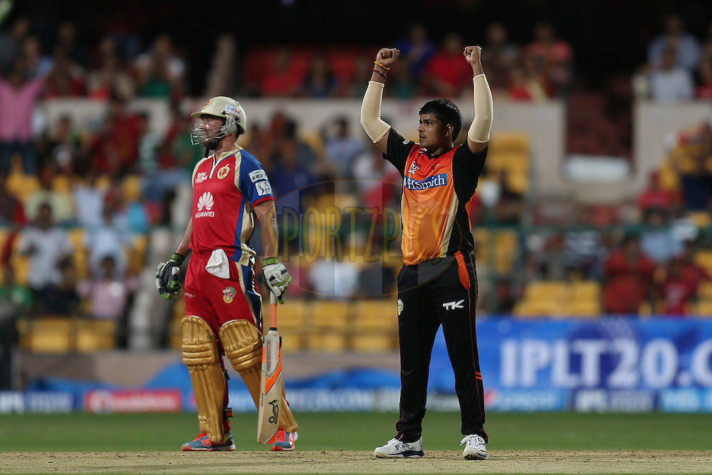 Karan Shukla celebrates a wicket during match 24 of the Pepsi Indian Premier League Season 2014 between the Royal Challengers Bangalore and the Sunrisers Hyderabad held at the M. Chinnaswamy Stadium, Bangalore, India on the 4th May 2014. Photo by Jacques Rossouw / IPL / SPORTZPICS<br /> <br /> <br /> <br /> Image use subject to terms and conditions which can be found here:  http://sportzpics.photoshelter.com/gallery/Pepsi-IPL-Image-terms-and-conditions/G00004VW1IVJ.gB0/C0000TScjhBM6ikg