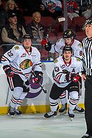 KELOWNA, CANADA - OCTOBER 20: Kieffer Bellows #22, Cody Glass #8 and Skyler McKenzie #43 of the Portland Winterhawks celebrate a third period empty net goal against the Kelowna Rockets on October 20, 2017 at Prospera Place in Kelowna, British Columbia, Canada.  (Photo by Marissa Baecker/Shoot the Breeze)  *** Local Caption ***