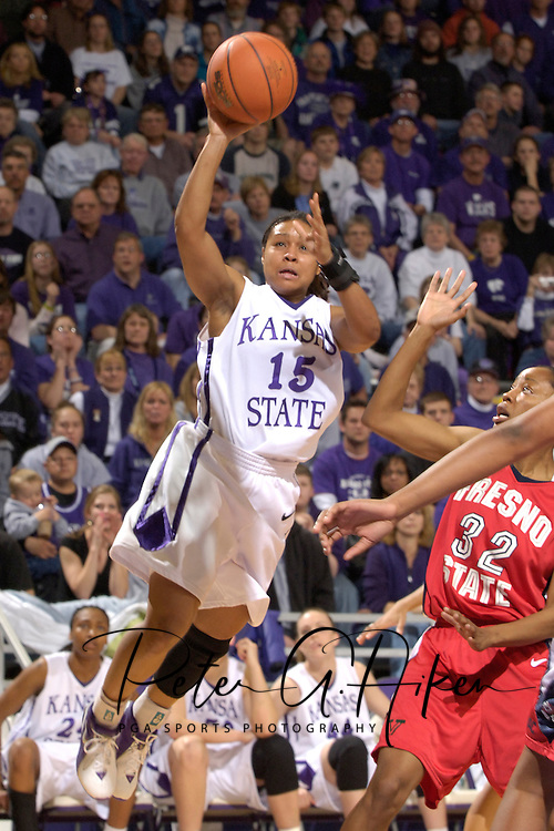 Kansas State guard Twiggy McIntyre (15) puts up a shot against Fresno State's Jasmine Plummer (32), during the second half at Bramlage Coliseum in Manhattan, Kansas, March 22, 2006.  K-State defeated the Bulldogs 64-61 in the second round of the WNIT.