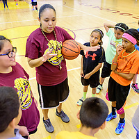 061015  Adron Gardner/Independent<br /> <br /> Tohatchi Cougar varsity girls basketball coach Tanisha Bitsoi, center, calls up a scrimmage during basketball campTohatchi High School Wednesday.