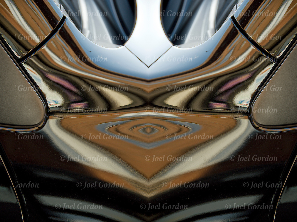 Image rotated and flipped horizontal then combined to form new image. Abstract reflections patterns off the surface of an automobile creating ripples of shapes and curves and waves.