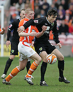Blackpool - Saturday March 7th, 2009: Keith Southern of Blackpool and Alan Gow of Norwich City in action during the Coca Cola Championship match at Bloomfield Road, Blackpool. (Pic by Michael Sedgwick/Focus Images)