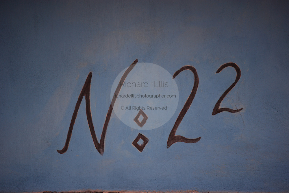 Detail of house number 22 in Golden Lane in Prague Castle, Prague, Czech Republic. House number 22 is where Franz Kafka lived. The castle, first constructed in the 10th century is the seat of government in the Czech Republic.