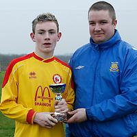 Frankie Gormley Clare Schoolboys Soccer League presents the MOTM award to Avenue's Cian Burke.<br />Photograph by Flann Howard