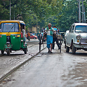 Rickshaw pullers share the busy Kolkata streets with all the motorized vechicles. They are often blamed for Kolkatas bad traffic.