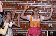 """Tamra Francis (right) leads a quick round of the """"Chicken Dance"""" during Mayhem & Mystery's production of """"Festival Fracas"""" at the Spaghetti Warehouse in downtown Dayton, Monday, September 27, 2010."""