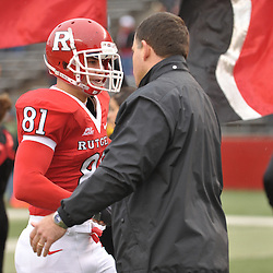 Dec 5, 2009; Piscataway, NJ, USA; Rutgers head coach Greg Schiano shakes hands with wide receiver Mark Harrison during the senior ceremony before first half NCAA Big East college football action between Rutgers and West Virginia at Rutgers Stadium.