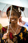 A woman holds an umbrella to protect herself from the sun in Garga Sarali, Cameroon on Tuesday September 15, 2009.