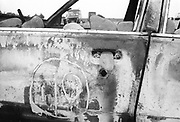 Burnt out car detail, The Mother Festival, Somerset, 1995