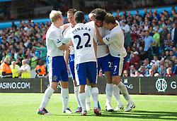 BIRMINGHAM, ENGLAND - Saturday, August 25, 2012: Everton's Marouane Fellaini celebrates scoring the second goal against Aston Villa with team-mates during the Premiership match at Villa Park. (Pic by David Rawcliffe/Propaganda)