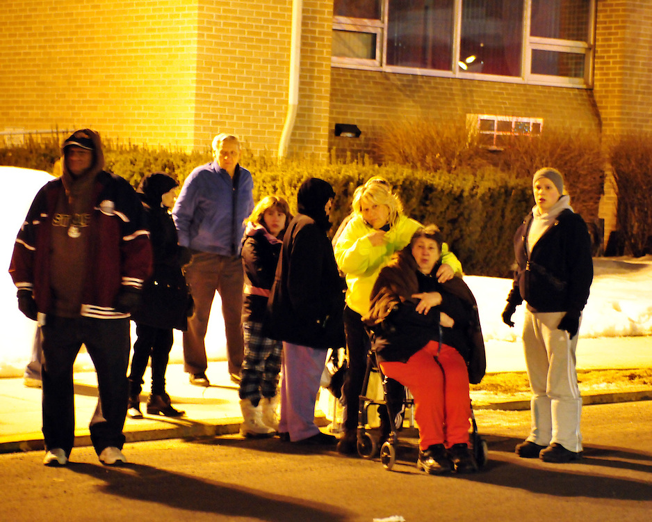 2/9/2011 Allentown, PA Emergency crews respond to a massive explosion Wednesday night in the area of 13th and Allen Street. Evacuees await bus transportation from Gross Towers. Express-Times Photo |CHRIS POST