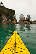 Kayaking along Split Apple Rock Beach, Abel Tasman National Park, New Zealand