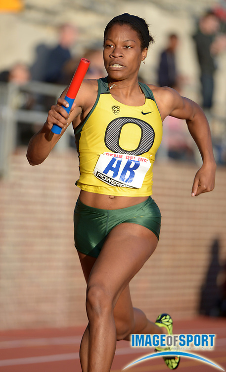 Apr 25, 2013; Philadelphia, PA, USA; Phyllis Francis runs the third leg on the Oregon womens 4 x 400m relay that won its heat in 3:35.37 in the 119th Penn Relays at Franklin Field.