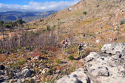 WELLINGTON SOUTH AFRICA - MARCH 22: Riders during stage three's 111km from Wellington to Worcester on March 22, 2018 in Western Cape, South Africa. Mountain bikers gather from around the world to compete in the 2018 ABSA Cape Epic, racing 8 days and 658km across the Western Cape with an accumulated 13 530m of climbing ascent, often referred to as the 'untamed race' the Cape Epic is said to be the toughest mountain bike event in the world. (Photo by Dino Lloyd)