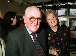 LORD & LADY JOHNSTON OF ROCKPORT at an exhibition in London on 20th May 1997.LYJ 14