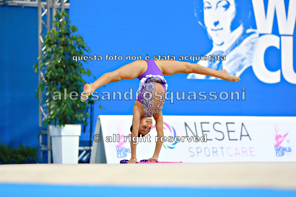 """Aghamirova Zohra during clubs routine at the International Tournament of rhythmic gymnastics """"Città di Pesaro"""", 03 April,2016. Zohra is an Azeri rhythmic gymnastics athlete born in Baku in 2001.<br /> This tournament dedicated to the youngest athletes is at the same time of the World Cup."""