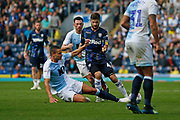 Leeds United midfielder Mateusz Klich (43) is fouled by Blackburn Rovers Jack Rodwell  during the EFL Sky Bet Championship match between Blackburn Rovers and Leeds United at Ewood Park, Blackburn, England on 20 October 2018.