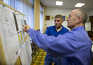 James Jordan (from left) of Ellsworth, Iowa talks with Hertz Real Estate Services farm manager Gary Loos about the property before the start of a farm auction at the Eagle Grove Masonic Lodge in Eagle Grove, Iowa on Thursday, October 18, 2012.