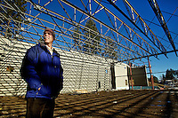 Matt Beam, the Kootenai Youth Recreation Organization manager, stands under the steel trusses of the new ice skating facility being built near the site of the former structure that collapsed in 2008 due to a heavy snow load. KYRO is anticipating the new facility will be open in August.