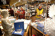 Ann Staples, left, and her husband, Richard, look through pop-up books at Tabula Rasa at Trolley Square on Black Friday in Salt Lake City, Friday, Nov. 23, 2012.