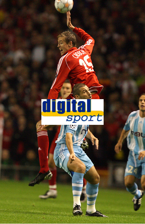 Photo: Paul Greenwood.<br />Liverpool v Marseille. UEFA Champions League, Group A. 03/10/2007.<br />Liverpool's Peter Crouch rises high above Lorik Cana to win the ball