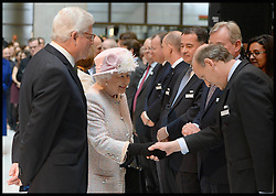 HM The Queen meets staff and  is escorted around the Lloyds of London building in the City of London, by The Chairman of Lloyds of London John Nelson (right) Thursday, 27th March 2014. Picture by Andrew Parsons / i-Images