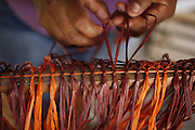 Barreirinhas_MA, Brasil.<br /> <br /> Processo de fabricao de artesanato de buriti no povoado de Marcelino. Na foto, artesa trabalha a fibra do Buriti usando um tear e a tecnica de Macrame.<br /> <br /> The manufacture of handicrafts process in the Buriti Marcelino Village. In this photo art of making macrame. <br /> <br /> Foto: LEO DRUMOND / NITRO
