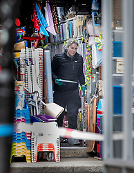 © Licensed to London News Pictures. 03/02/2020. London, UK. A policewoman gathers evidence inside the Low Price Store on Streatham High Road the day after a terrorist stabbed two people before being shot dead by police. Sudesh Amman, who was released from prison recently for terror offences, was under active police surveillance at the time of the attack - which police think was an Islamist-related terrorist incident. Photo credit: Peter Macdiarmid/LNP