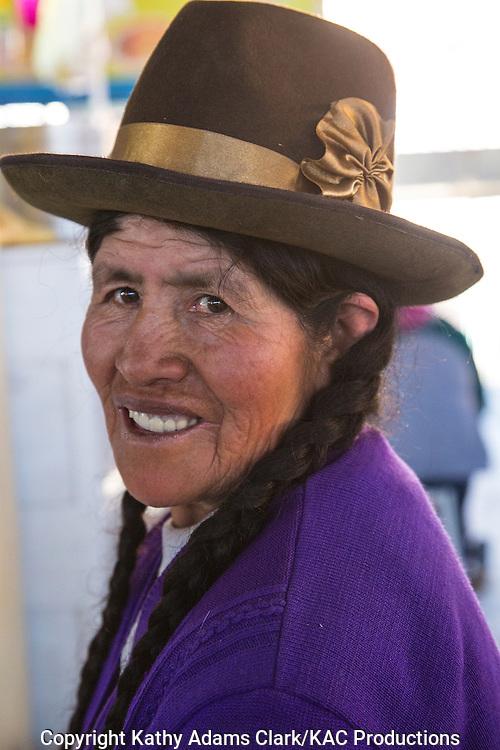 Lady in traditional dress in Cusco, Peru. Hat denotes village or region.
