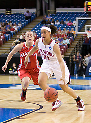 March 27, 2010; Sacramento, CA, USA; Stanford Cardinal guard Rosalyn Gold-Onwude (21) dribbles past Georgia Bulldogs guard Ashley Houts (1) during the first half in the semifinals of the Sacramental regional in the 2010 NCAA womens basketball tournament at ARCO Arena. Stanford defeated Georgia 73-36.