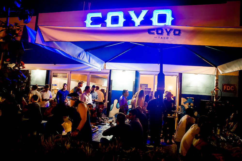 MIAMI, FLORIDA -- July 11, 2015 -- Tacos are served at Coyos Taco during the colorful and vibrant Art Walk in the Wynwood Art District Miami, Florida.  The event on the second Saturday of every month features not only public art, but gallery tours, dining at a myriad of restaurant and a party atmosphere after dark.  (PHOTO / CHIP LITHERLAND)