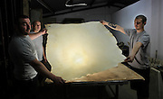 The team shows the dry skin used as a parchment at the tannery factory of Scriptorium SL in Valencia, Spain. Picture by Manuel Cohen