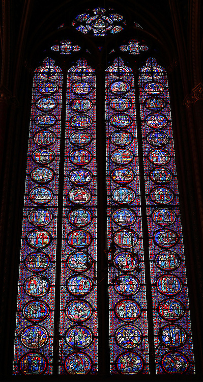 Detail of a window group in the nave of the upper chapel of La Sainte-Chapelle (The Holy Chapel), 1248, Paris, France. Each window group has four lancets topped by three rose windows. La Sainte-Chapelle was commissioned by King Louis IX of France to house his collection of Passion Relics, including the Crown of Thorns, and is considered among the highest achievements of the Rayonnant period of Gothic architecture. Picture by Manuel Cohen