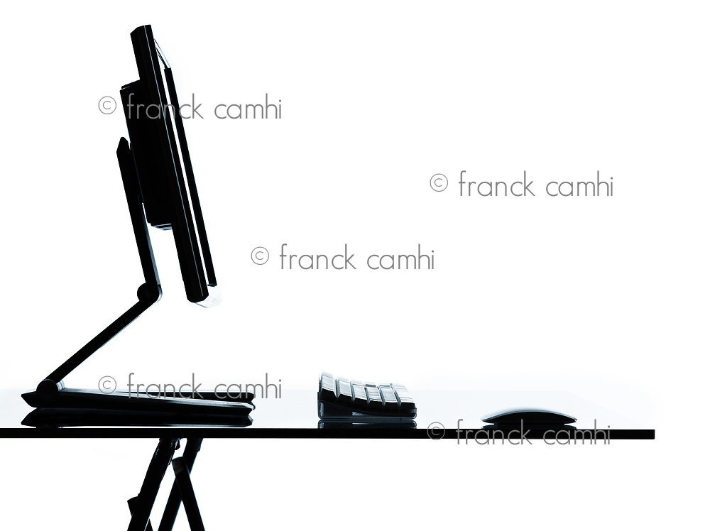 one computer on a table silhouette in studio isolated on white background