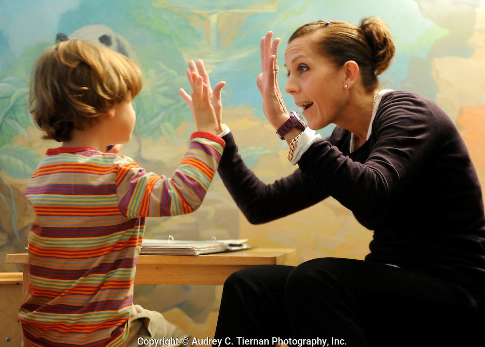 New York, NY:  A young student receives a high five and some encouragement from his teacher. Copyright: Audrey C. Tiernan