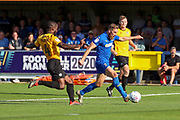 AFC Wimbledon midfielder Scott Wagstaff (7) with a shot at goal during the EFL Sky Bet League 1 match between AFC Wimbledon and Bristol Rovers at the Cherry Red Records Stadium, Kingston, England on 21 September 2019.