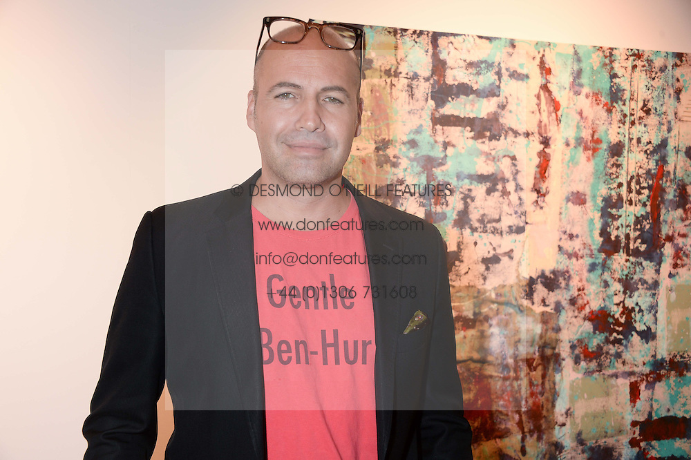 BILLY ZANE at a private view of an exhibition of paintings by Billy Zane entitled 'Save The Day Bed' held at the Rook & Raven Gallery, Rathbone Place, London on 10th October 2013.