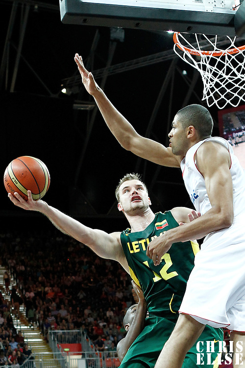 02 August 2012: Lithuania Antanas Kavaliauskas goes for the layup against Nicolas Batum during 82-74 Team France victory over Team Lithuania, during the men's basketball preliminary, at the Basketball Arena, in London, Great Britain.